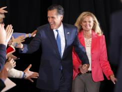 Mitt Romney and his wife, Ann. greet supporters as they arrive at a primary rally in Boston on Tuesday.