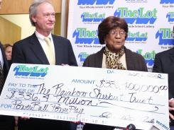 Louise White, 81, is presented a check for $336.4 million by Gov. Lincoln Chafee.