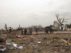 Soldiers walk through the blast zone on Wednesday in Brazzaville, Republic of Congo.
