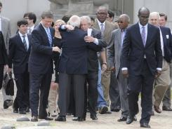 Casino owner Milton McGregor hugs a supporter as he exits the federal courthouse in Montgomery, Ala., with his legal team on Wednesday.