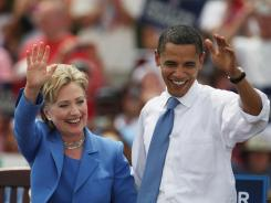 Hillary Clinton and Barack Obama, then U.S. senators, make their first joint campaign appearance in Unity, N.H., on June 27, 2008.