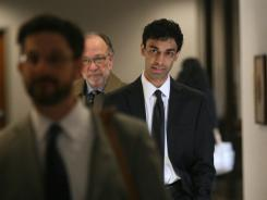 Dharun Ravi, right, walks with lead defense attorney Steven Altman, center, outside the Middlesex County (N.J.) courtroom on Wednesday.