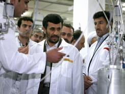 South of Tehran:  Iranian President Mahmoud Ahmadinejad, center, at a nuclear facility.