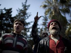 Mourners chant anti-government slogans during a funeral Thursday in Idlib, Syria.