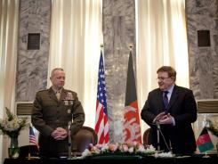 U.S. General John Allen, left, and Afghan Defense Minister Gen. Abdul Rahim Wardak attend a signing ceremony in Kabul on Friday.