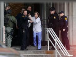 Police help employees of Western Psychiatric Institute and Clinic evacuate the building on Thursday in Pittsburgh.