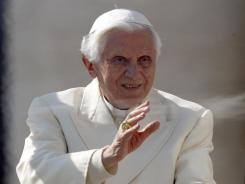 Pope Benedict XVI smiles during his weekly general audience in St. Peter's Square at the Vatican on Wednesday.