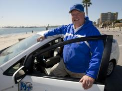 Cliff Ricketts steps out of his car in Long Beach, Calif., on Thursday after leading a cross-country journey using three separate vehicles powered by alternate fuels.
