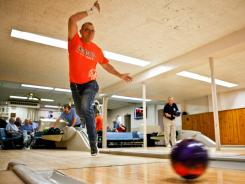 Gary Heinz bowls at the St. Boniface Bowling Alley underneath St. Ann Catholic Church in Peoria, Ill., in February. Many older churches built bowling alleys in the basement to provide safe, cost-free entertainment during the Great Depression.
