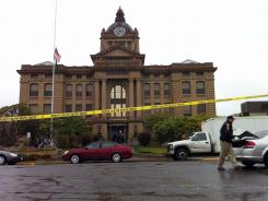 Police search for the man who stabbed Superior Court Judge Dave Edwards and shot a corrections officer in Montesano, Wash., on Friday.