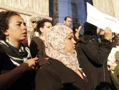 Egyptian activist Samira Ibrahim, center, attends a rally in downtown Cairo on Thursday to mark International Women's Day.