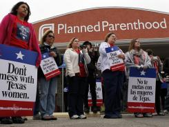 "Local citizens and employees of the Planned Parenthood clinic in San Angelo, Texas, gather in front of the clinic Thursday to participate in the ""Don't Mess with Texas Women"" rally."