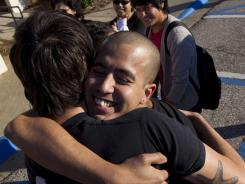 Mohammad Abdollahi, left, hugs Nicolas Gonazalez after he was released from jail in Montgomery, Ala., in November. Gonzalez was one of 13 people arrested at a protest of Alabama's immigration law.