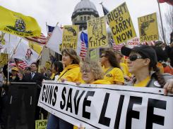Supporters of gun rights participate in an Illinois Gun Owners Lobby Day at the state Capitol on March 7 in Springfield, Ill.