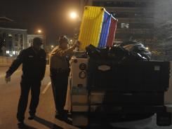 State troopers load a truck with Occupy Nashville protester Chris Humphrey's tent and other materials early Monday.