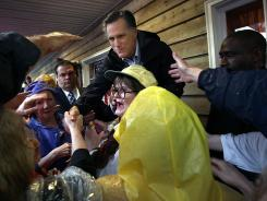 Mitt Romney greets supporters during a campaign stop at the Whistle Stop cafe in Mobile, Ala.