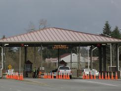Guards monitor the gate Sunday at Joint Base Lewis-McChord.