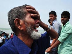 A man reacts near the scene of a rescue operation after a ferry accident in Munshigong, Bangladesh.