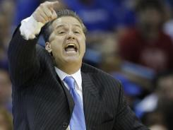 Mad man: John Calipari, Kentucky basketball coach, yells instructions Friday in New Orleans.