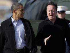 President Obama and British Prime Minister David Cameron walk to Air Force One on Tuesday at Andrews Air Force Base, Md.
