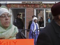 Imam Konate Souleimane, center, emerges from a meeting with New York City Police Commissioner Raymond Kelly as other Muslim leaders, excluded from the meeting, hold a news conference on Friday at police headquarters in New York. Imam Souleimane was among a few select leaders who met with Kelly over the police department's spy program in Muslim communities across the Northeast.