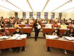 "Students from under-performing schools attend a college preparation program held at New York University on Saturday with teacher Nicole McCauley. The program uses ""cram school"" techniques, to prepare low-income minority high schoolers for college."