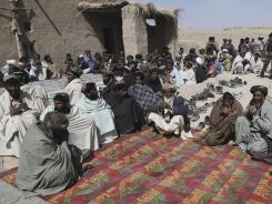 Villagers gather Tuesday to pray for the victims of Sunday's massacre in Panjwai, Afghanistan.