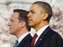 President Obama welcomes British Prime Minister David Cameron during an arrival ceremony at the White House Wednesday.