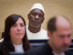 Congolese militia boss Thomas Lubanga sits in the International Criminal Court at the Hague on Wednesday.