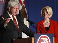 Former House speaker Newt Gingrich makes a campaign stop Wednesday in Rosemont, Ill., with his wife, Callista. He finished second in Alabama and Mississippi on Tuesday.