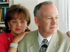 John Ramsey and his late wife, Patsy, at the law offices of Lin Wood in 2000.