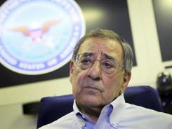 Secretary of Defense Leon Panetta fields questions from the media on a flight to Kyrgystan on Monday regarding the American soldier who is accused of killing 16 Afghan civilians.