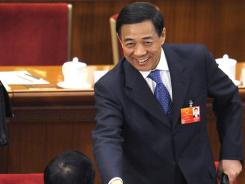 Bo Xilai, Communist Party secretary of Chongqing, shakes hands with other delegates at the National People's Congress annual session March 9 in Beijing.