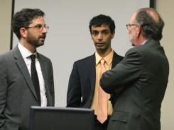 Dharun Ravi stands with his attorneys at the defense table following a question from the jury during his trial in New Brunswick, N.J., on Wednesday.