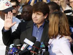 Former Illinois governor Rod Blagojevich, with his wife, Patti, at his side, speaks to the media on Wednesday in Chicago.