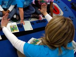 Fewer teachers think that linking salaries to student test scores will help retain good instructors, a survey finds.