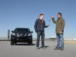 """""""Probably better than driver's ed"""":  Alan Lewis passes the car keys to his son Andy, 17, at the Indianapolis Motor Speedway."""