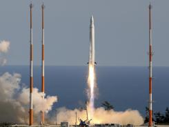 South Korea's first rocket, the South Korea Space Launch Vehicle-1, blasted off into space Aug. 25, 2009.