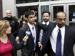 Dharun Ravi, center, is helped by his father, Ravi Pazhani, right, as they leave court Friday.