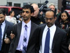 Dharun Ravi, left, is hugged by his father, Ravi Pazhani, as they leave court on Friday.