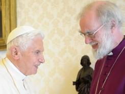Pope Benedict XVI, left, greets Archbishop of Cantebury Rowan Williams prior a private audience at Vatican on March 10.