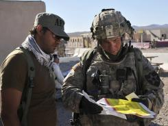 Army Staff Sgt. Robert Bales, right, participates in an exercise Aug. 23 at the National Training Center at Fort Irwin, Calif.