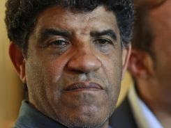 In this Sunday, Aug. 21, 2011 file photo, Abdullah al-Senoussi, head of Libyan intelligence, speaks to the press in Tripoli.
