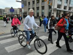 Fans in Indianapolis use bicycles to get around the streets near Super Bowl Village in January.