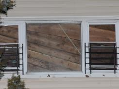 The collapsed ceiling is seen through a second floor window of the house that suffered an internal collapse in the Rockaway section of Queens.