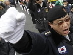 South Korean war veterans shout slogans during an anti-North Korea rally on Friday in Seoul.