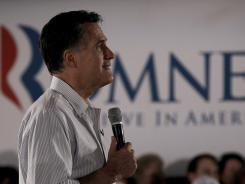 Mitt Romney listens to a question during a campaign stop Saturday in Collinsville, Ill.