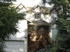 News crews gather Friday outside the home of Staff Sgt. Robert Bales in Lake Tapps, Wash.