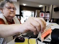 Voter registration: Lucille Myers scans a voter's driver's license in Carl Junction, Mo., last month.