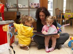 Ellie Lavi, an American-Israeli, plays with her daughters, Maya, left, and Shira, at their home in Tel Aviv. Lavi had trouble when she applied for U.S. citizenship for them.